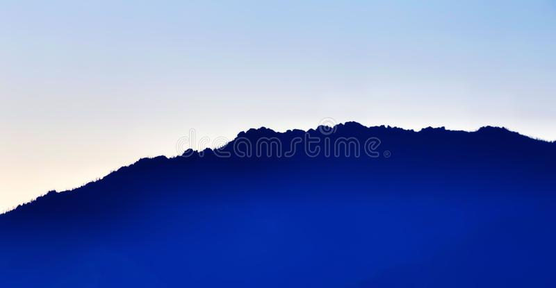 The blue outline of the mountain stock images