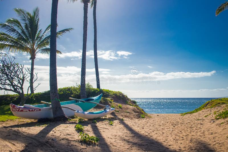 Blue outrigger on the beach in Kihei, Maui stock photo