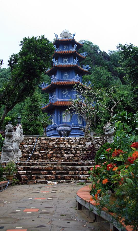 Blue Pagoda on Marble Mountain. Ust off the Danang Beach coastal road, the Marble Mountains Ngu Hanh Son consist of five craggy marble outcrops topped with stock photo