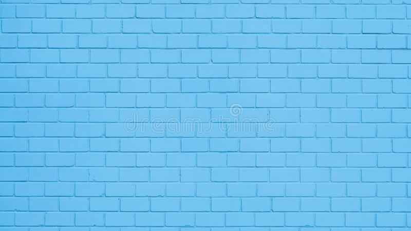 Blue painted brick wall. Texture of a blue painted brick wall as a background or wallpaper stock images