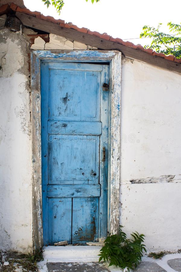 Antique blue painted front door on house in Greece. Traditional Greek architecture. Blue painted front door on old house in Greece. Typical Greek architecture stock images