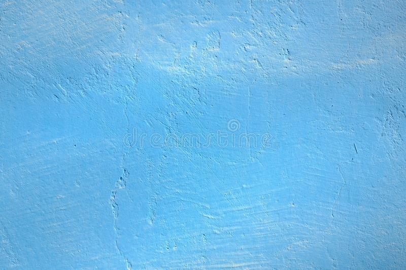 Blue painted grunge concrete wall for backgrounds royalty free stock photos