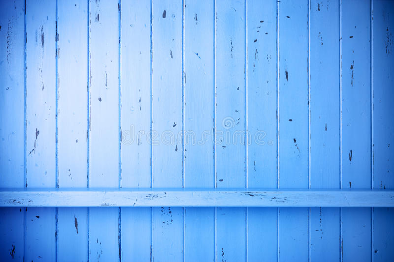 Blue Painted Wood Rustic Background. A blue painted rustic wood background with a shelf or crossbeam. Could be a fence or a wall