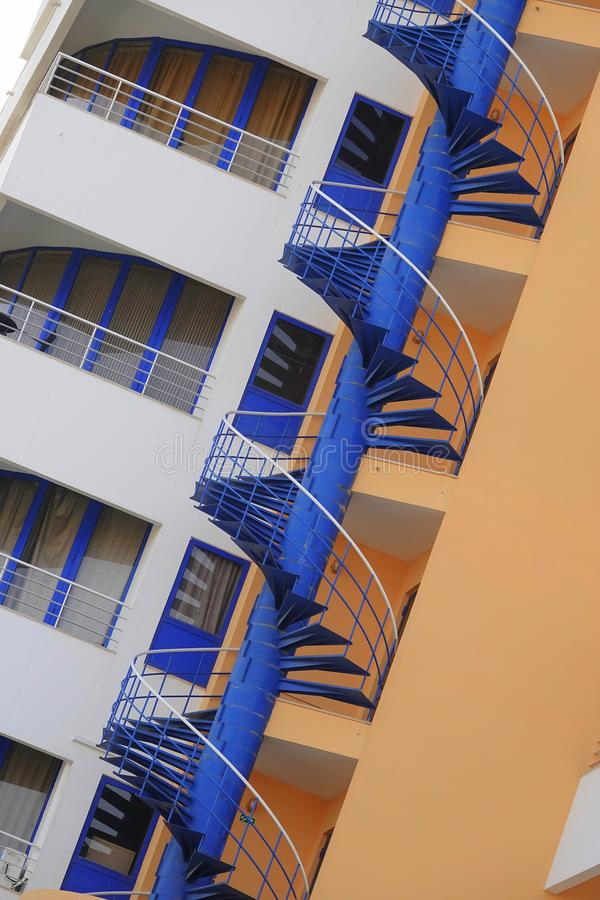 Blue painted steel spiral fire escape stock images