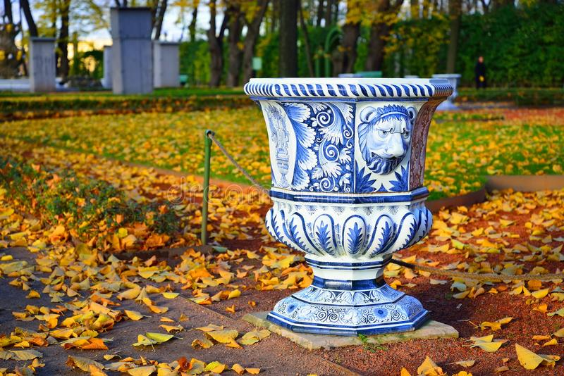 Blue painted urn-vase in the Summer Garden in autumn.  royalty free stock photography