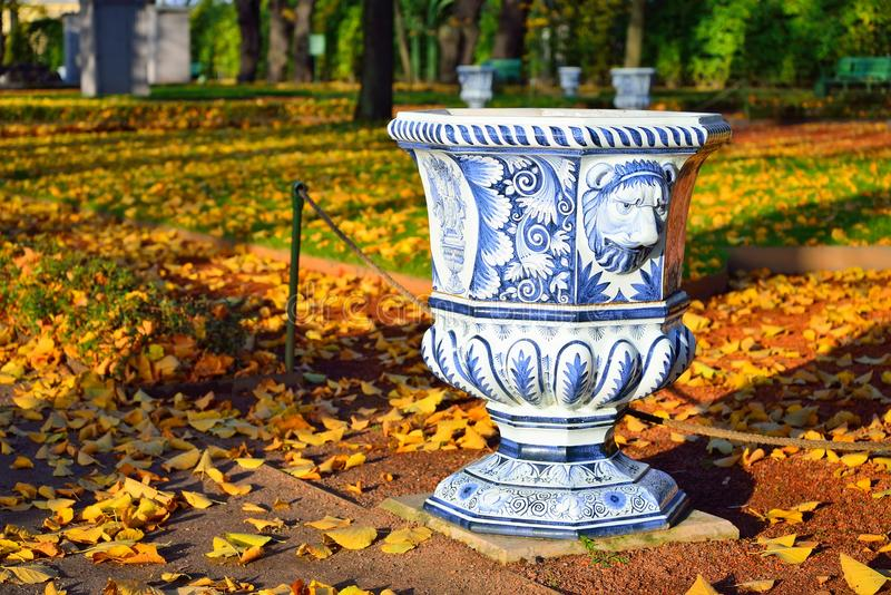 Blue painted urn-vase in the Summer Garden in autumn on a Sunny. Day. St. Petersburg stock photography