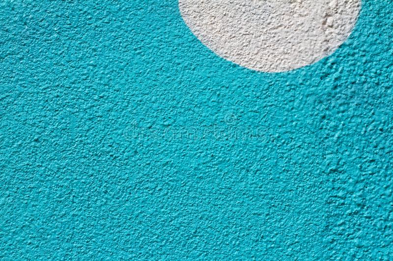 Blue painted wall with white semicircle royalty free stock photo