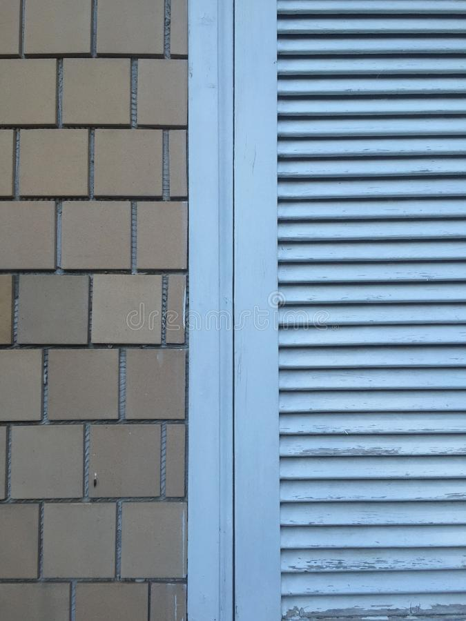 Blue painted window shutter with tiles stock photos