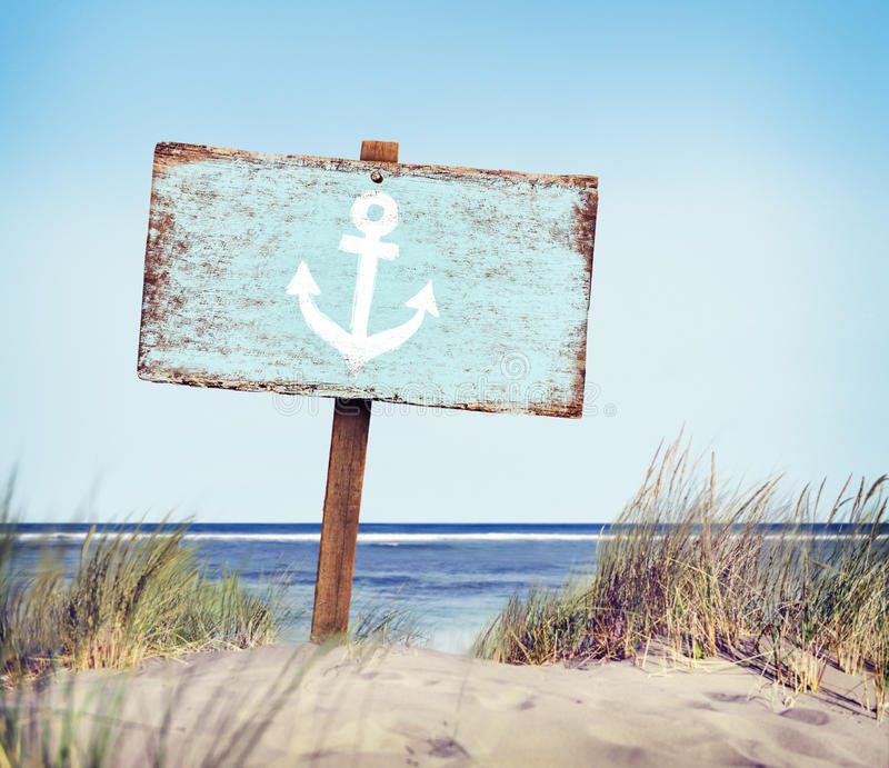 Blue Painted Wood Label on Beach stock photos