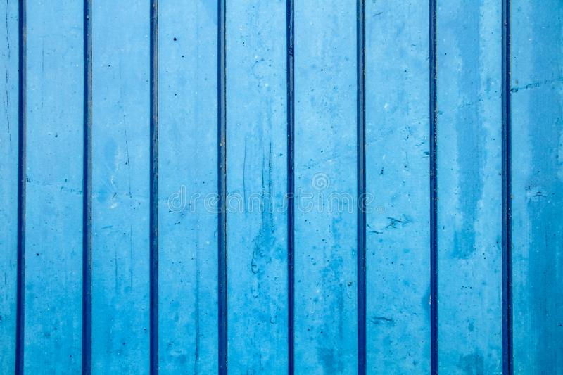 Blue painted wooden wall plank perpendicular to the frame as simple saturated blue oil paint timber wood background. Blue painted wooden wall plank perpendicular royalty free stock photos