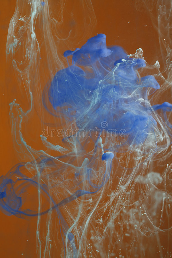 Blue paints dissolving royalty free stock images