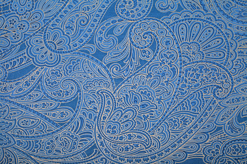 Blue paisley pattern wallpaper. Vintage blue wallpaper with paisley pattern stock photography