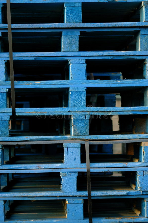 Blue Pallets. A close up shot of a collection of stacked, blue, industrial/commercial pallets ready to go and be reused. Shot on a Nikon D70, in Derby, UK royalty free stock photos
