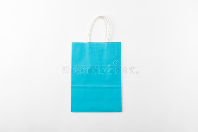 blue paper bag with handles on a white background top view stock images