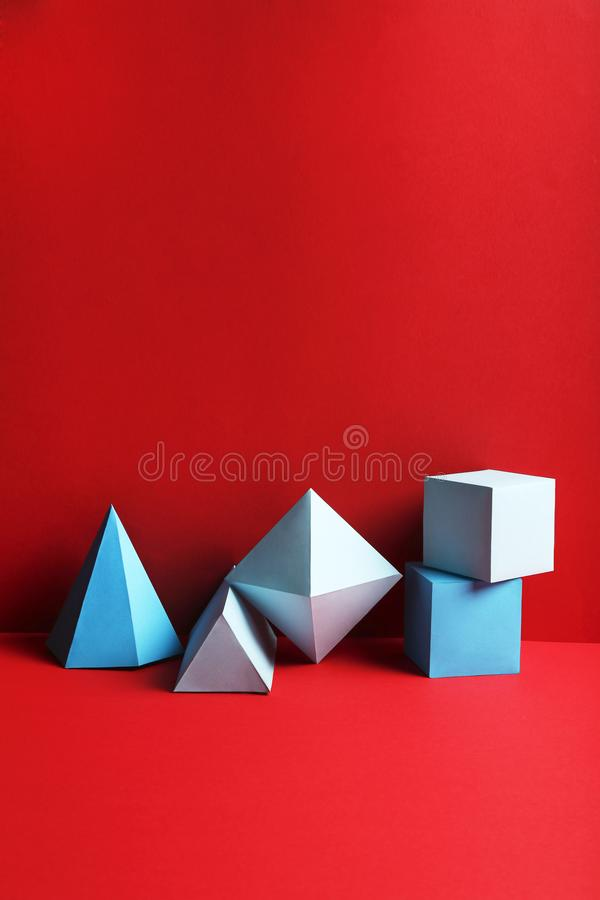 Blue paper geometric figures royalty free stock photography