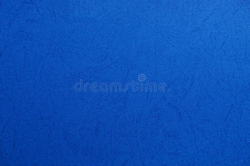 Blue paper texture of a piece of cardboard with a pattern stock photo