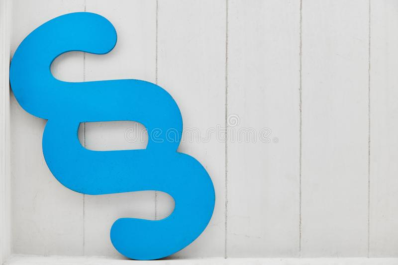 Blue paragraph as concept for law and law. In front of a wood background stock photo