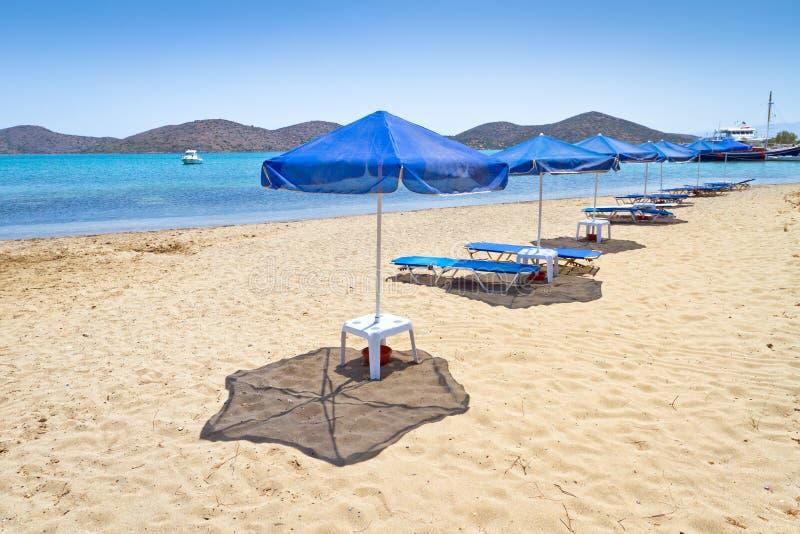 Blue parasols at Aegean Sea stock photo