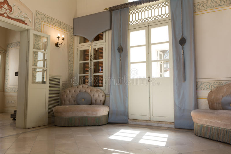 Blue Parlor. Classic middle eastern parlor with French windows stock photo
