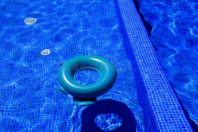Blue peldridge for kids at swimming pool. royalty free stock photo