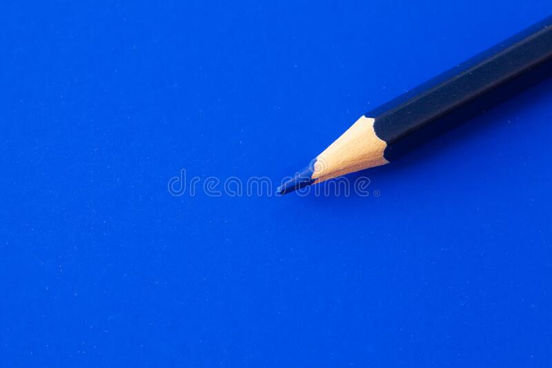 Blue pencil for drawing on a blue. Background royalty free stock image