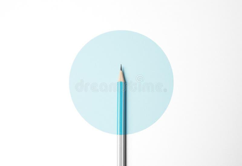 Blue pencil on white background, minimalism. Creativity, idea, solution, creativity concept.  stock images