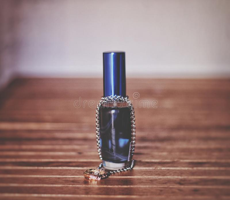 Blue perfum. A blue perfum with a necklace stock images