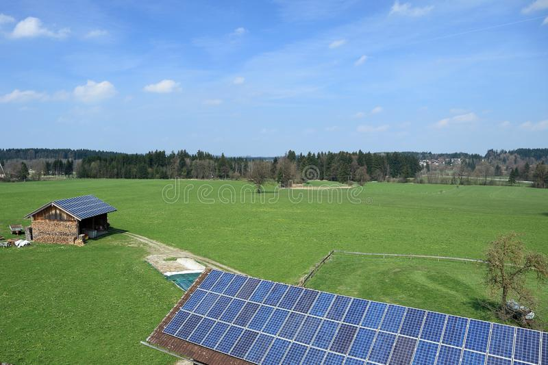 Blue photo-voltaic cells. Some different roofs with blue photo-voltaic cells stock image