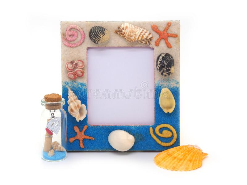 Blue picture frame  sea shell  on white background stock image