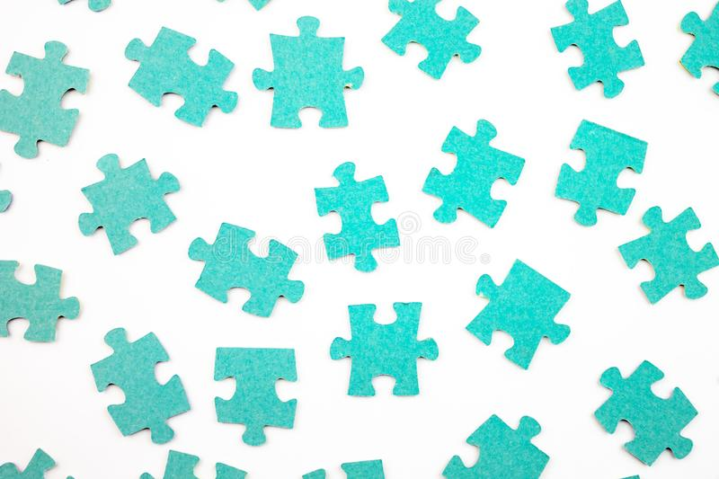 Blue pieces of puzzle on white background, top view royalty free stock image
