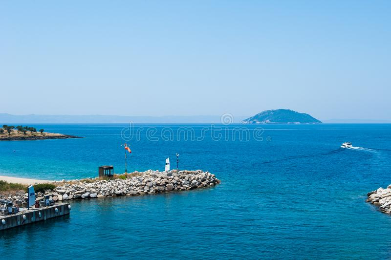 Blue pier, Water on the sea from the hill, the boat sails on the sea royalty free stock photo