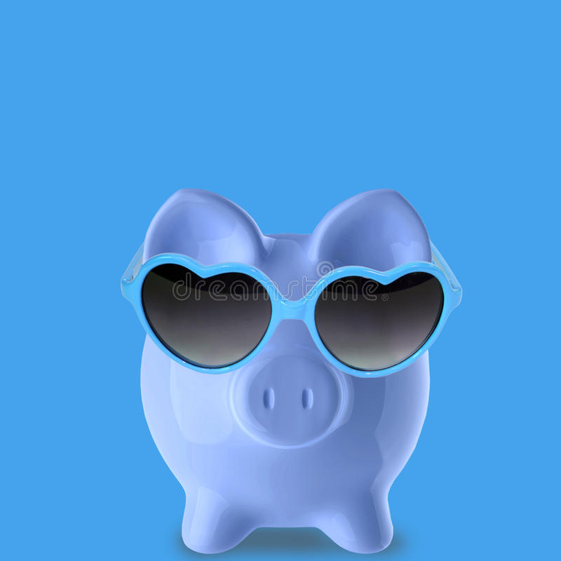 Blue Piggy Bank. In blue background royalty free stock photo