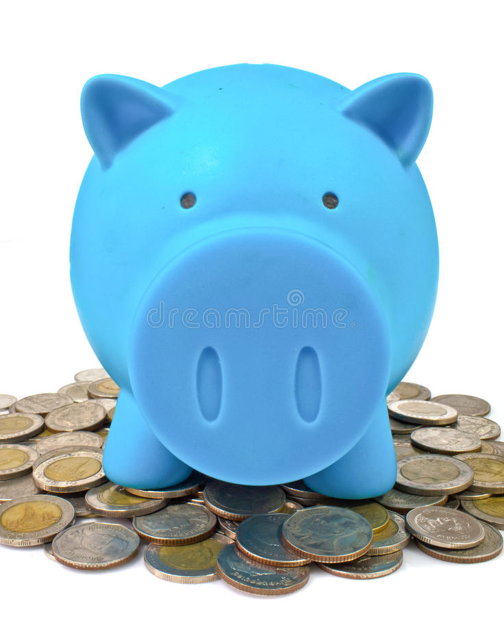 Blue piggy bank with coins. Blue piggy bank with some coins stock image