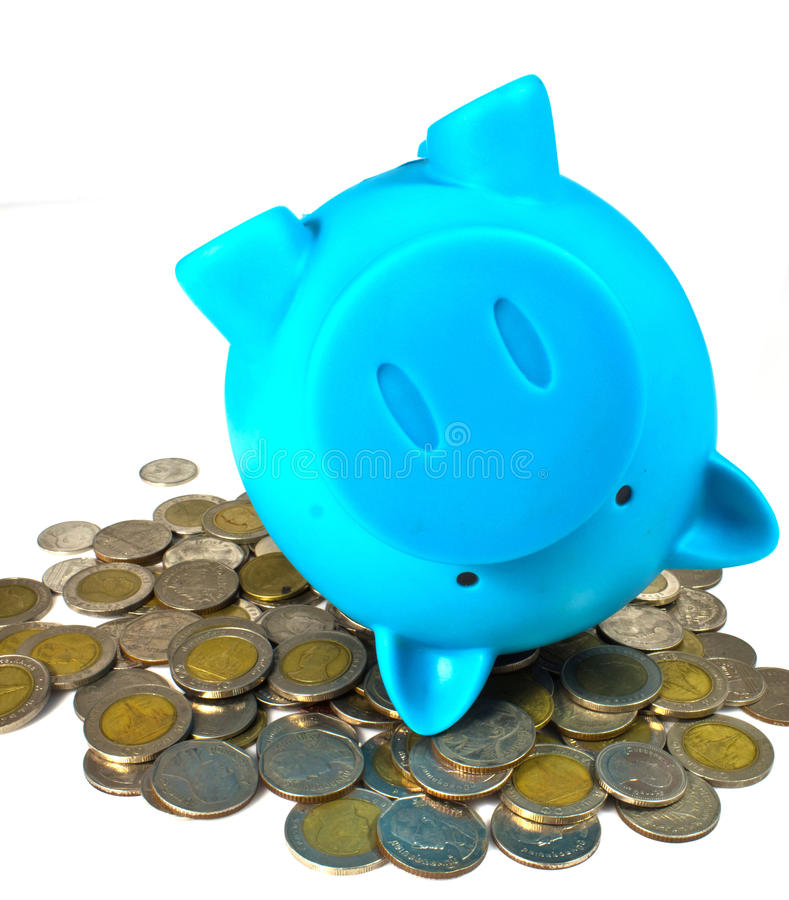 Blue piggy bank with coins. Blue piggy bank with some coins stock photo