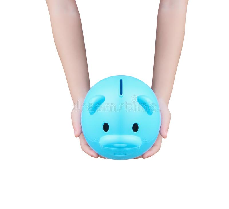 Blue piggy bank or colorful empty money savings box and asian little   child hand holding isolated on white background with. Close up Blue piggy bank or colorful royalty free stock photography