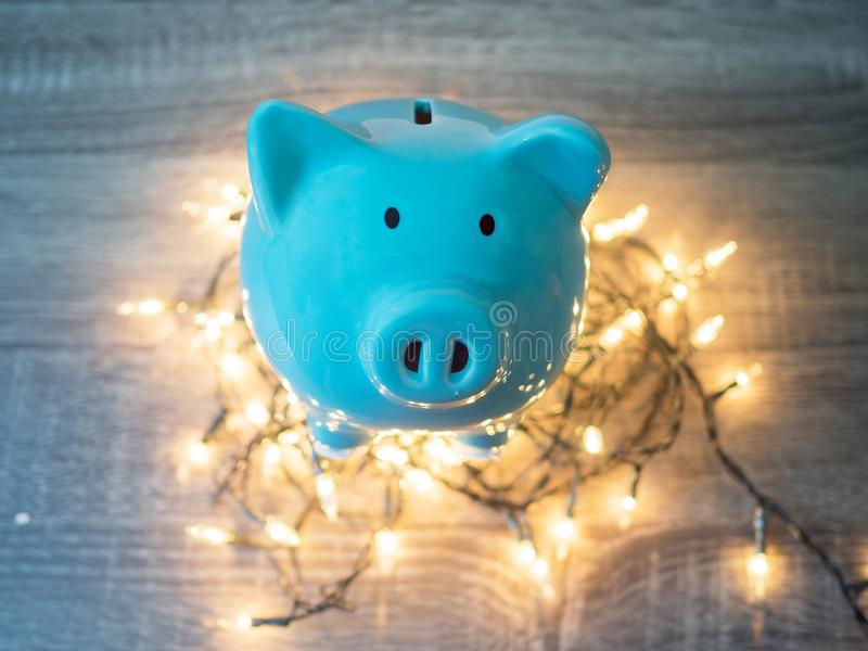 Blue piggy bank with Party lights, Enjoy savings for the holidays concept.  stock photo