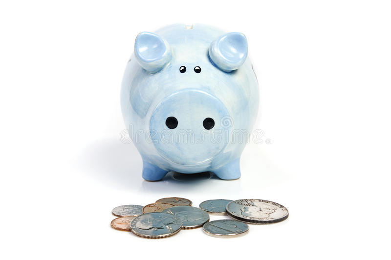 Blue piggy bank savings. And coins on white isolated stock photo