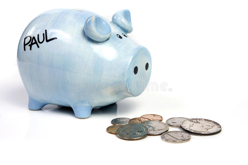 Blue piggy bank savings. And coins on white isolated royalty free stock images