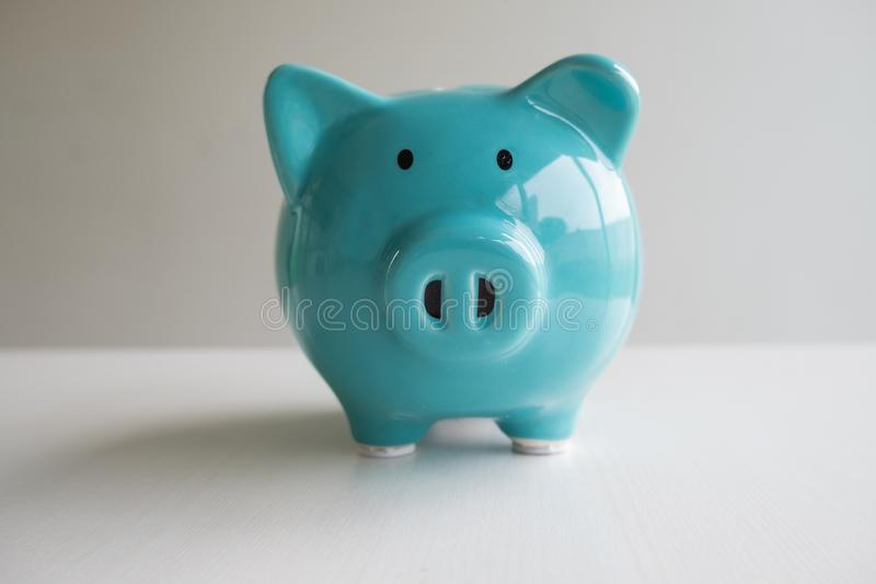 Blue piggy bank with white background, step up growing business to success and saving for retirement concept.  royalty free stock photos