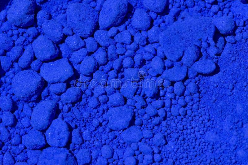 Blue pigment. Blue ultramarine pigment as background stock photography