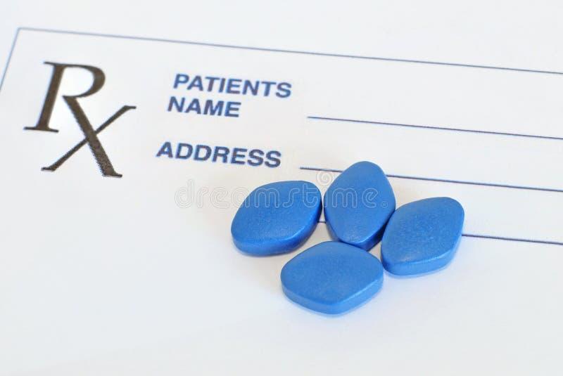Blue pills for erectile dysfunction treatment. With prescription paper stock images