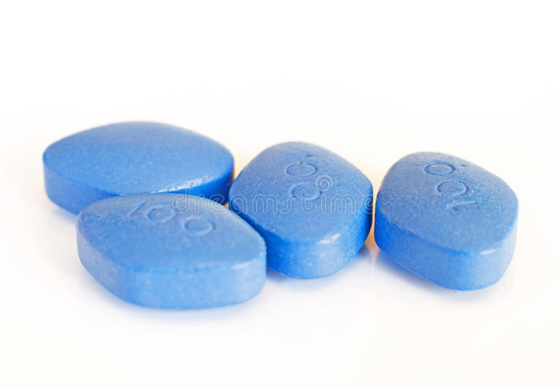 Blue pills for erectile dysfunction treatment stock images