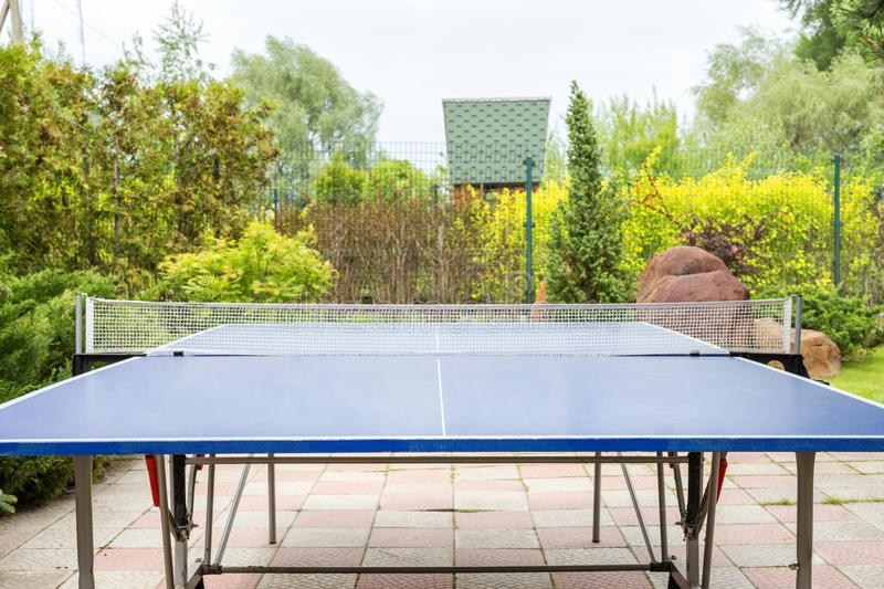 Blue ping pong table outdoors. Table tennis equipment in park. Front view, product display stock photos