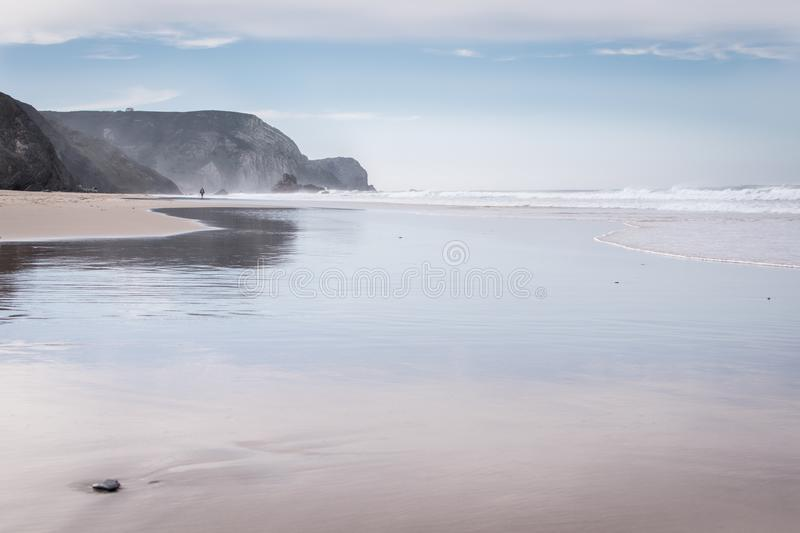 Empty sandy beach in Portugal royalty free stock photo