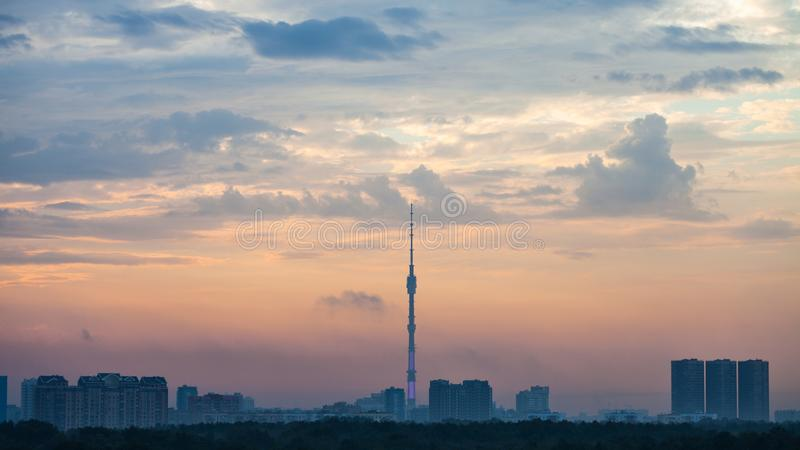 Blue and pink dawning over Moscow city. With Ostankino TV Tower and Timiryazevskiy park in summer morning stock photos