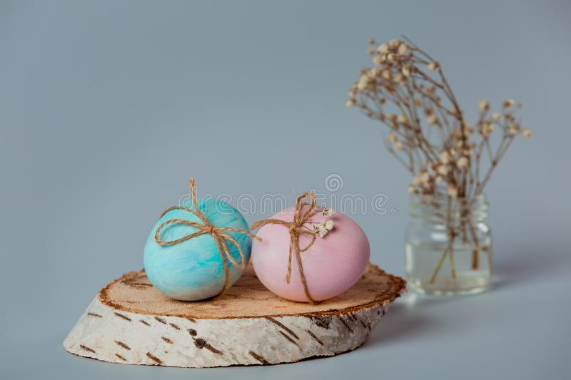 Two eggs. Decorating eggs. Easter is coming soon. Blue and pink egg is decorated with a thread.nEaster decor. nBlue and pink egg is decorated with a thread on a royalty free stock photos