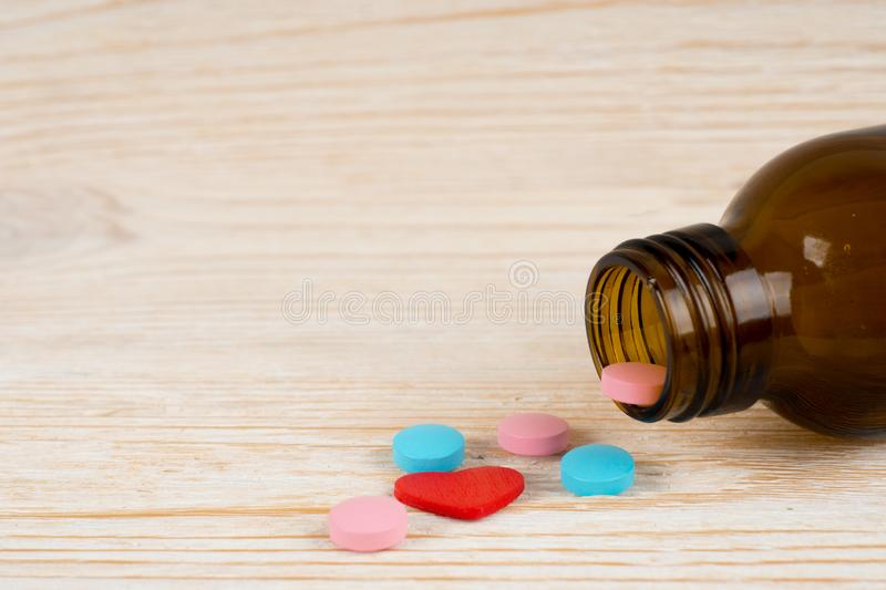 Blue and pink love pills royalty free stock photo