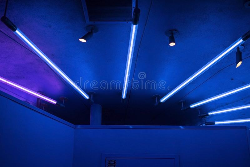 Blue and pink neon light strips royalty free stock photography