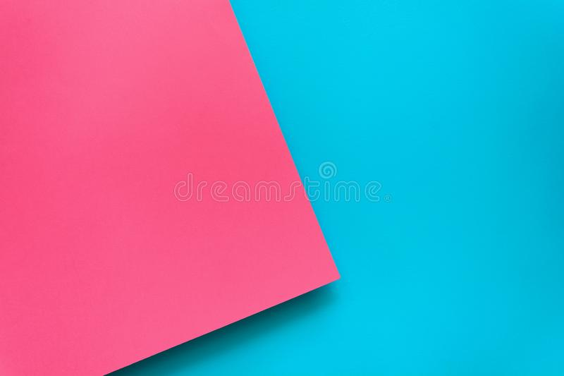 Blue and pink pastel color papered background. Volume geometric flat lay. Top view. Copy space.  royalty free stock image