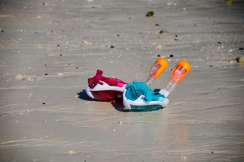 Blue and pink Snorkel did people put on the beach. Blue and pink Snorkel did people put on beach royalty free stock photo